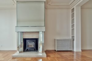 An empty room with a fireplace.