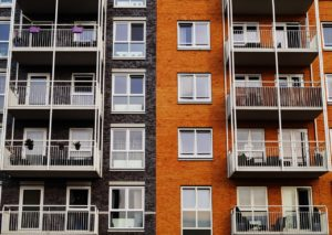 Apartment building in renting vs. buying