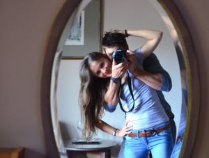 Couple taking photos in the mirror