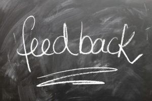 A chalkboard with feedback written on it