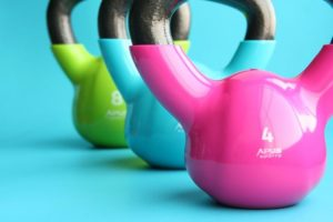 Three kettle-bells used in exercises for football players