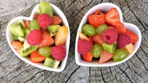 Two bowls with various types of fruit