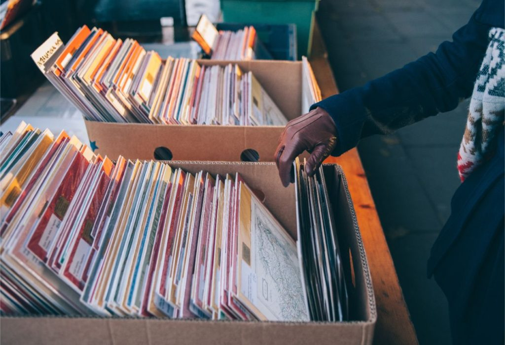 A person browsing records on a garage sale.