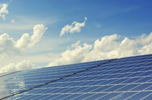 Solar panels under a sun.