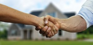 Hand shake - making a deal when buying your first rental property