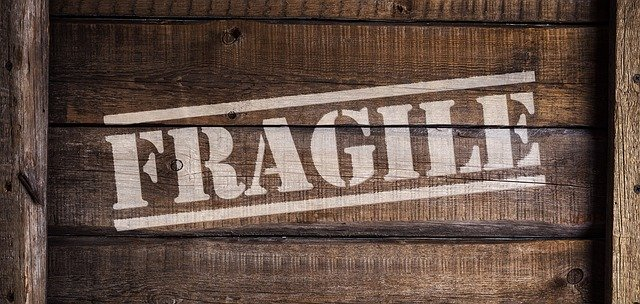 A box labeled fragile because proper labeling is one of the ways to ensure your items' safety when moving.