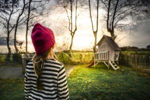 A girl in a backyard.