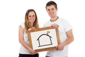a couple holding a graphic image of a house