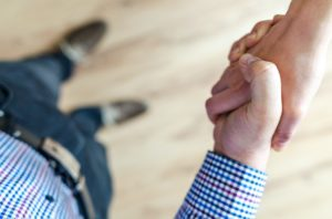 There are two people shaking hands, because making a good deal is very important when buying a new home in Idaho.