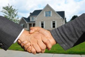 Shaking hands after buying a house in Eagle, ID.