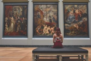 A woman sitting in an art gallery
