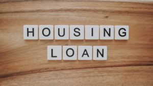Housing loan spelled out with white blocks with black letters.
