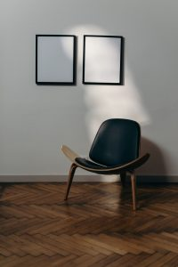 Chair and two blank paintings.