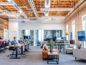 People working inside coworking office space.