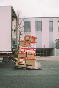 packed moving boxes before they are loaded onto a moving truck