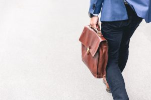 A man carrying a suitcase, going to work.