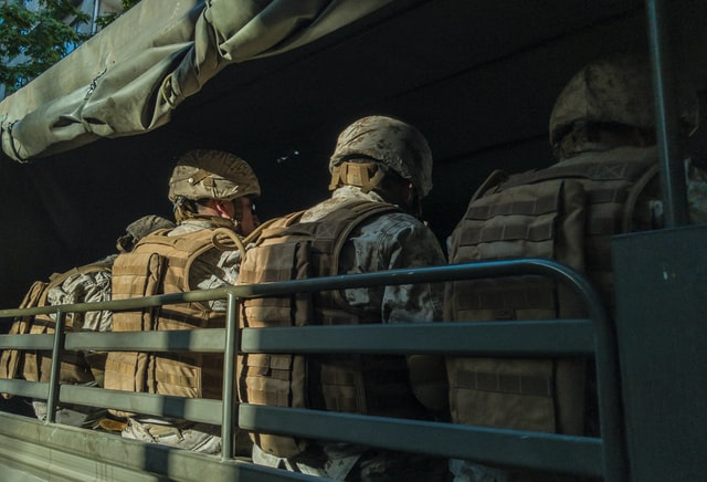 soldiers in truck, read Moving tips for military personnel
