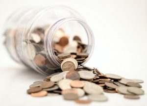 Coins symbolizing the money one needs to buy a property in one of the Ohio neighborhoods.