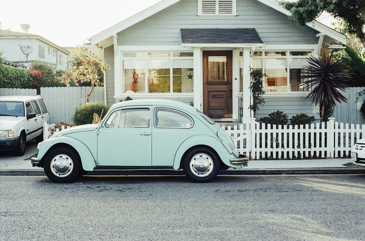 A car parked in front of a house