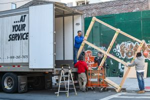 Movers in Toronto loading a moving truck after buying a Downtown Toronto apartment.