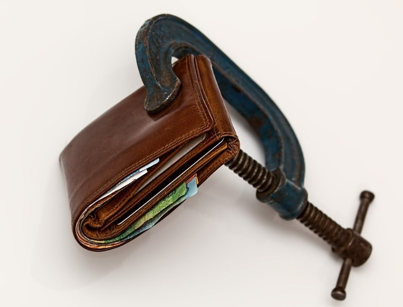 A wallet that is being squeezed - as a way to save money for your down payment.