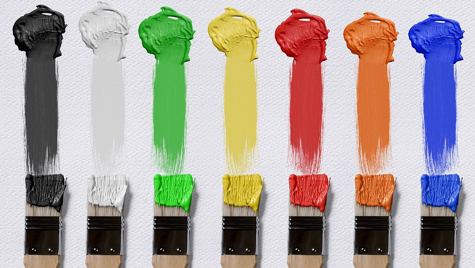 Brushes dipped in all kind of different colored paints.