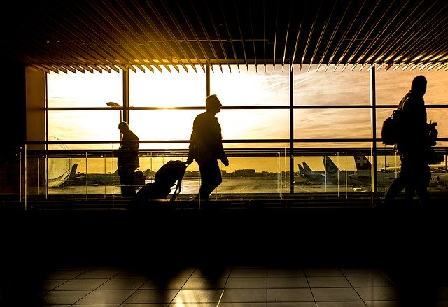 A man at an airport after making a decision to move overseas during the coronavirus pandemic