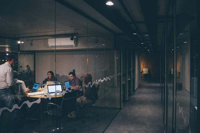People talking in the meeting room.
