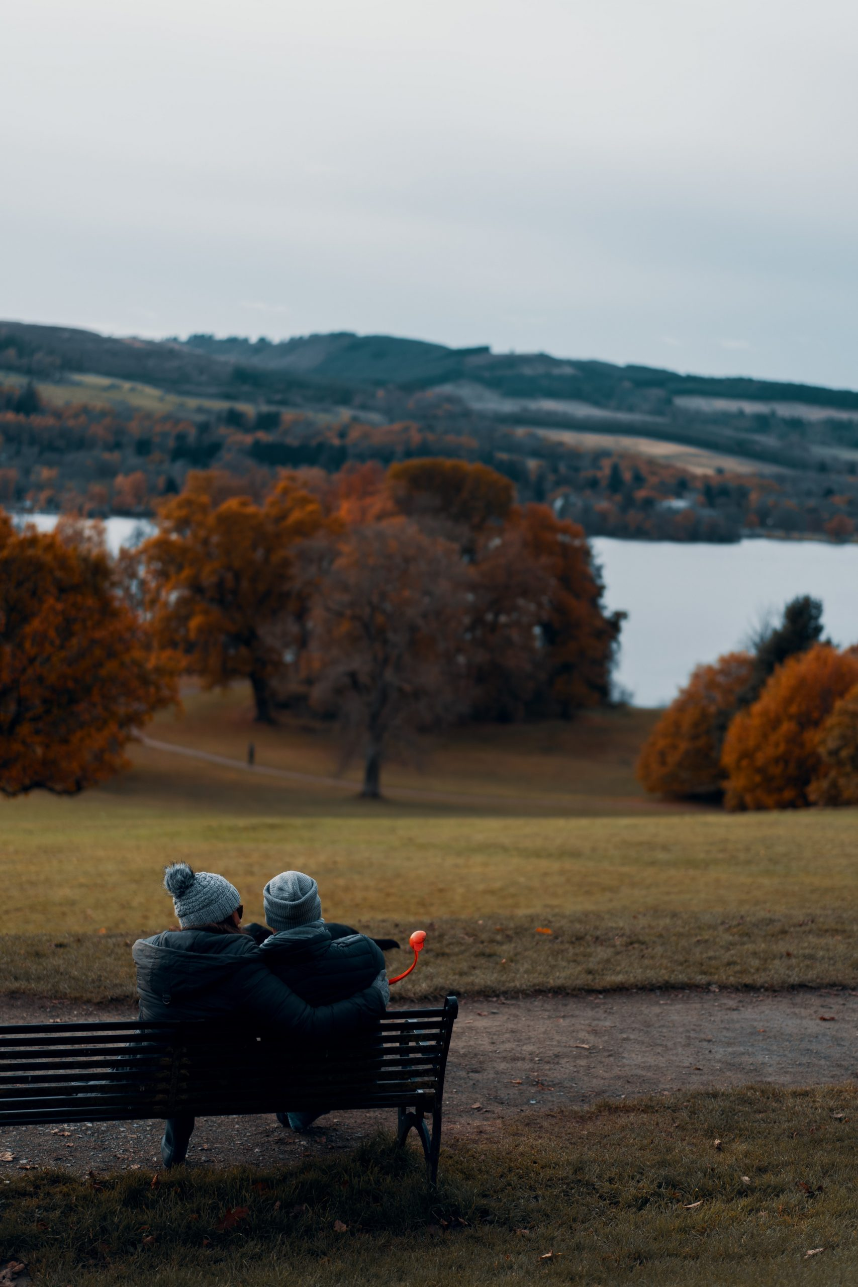 A couple sitting on the bench and enjoying the view on their mission to explore Auburn Hills.