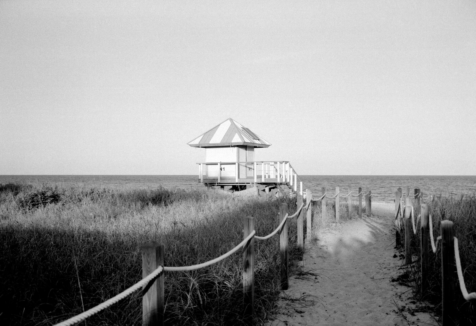 a black and white image of a beach in Delray Beach, there are many benefits of having a second house in Delray Beach