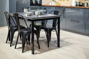 A kitchen with a black dining table and four chairs symbolizing what is appealing to Virginia home buyers