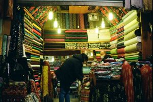 Man and woman selling carpets at night hours